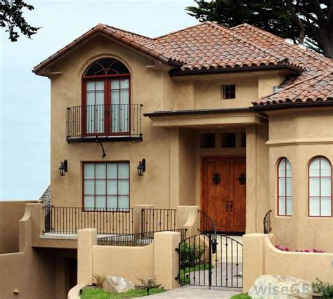 what are the pros and cons of stucco construction