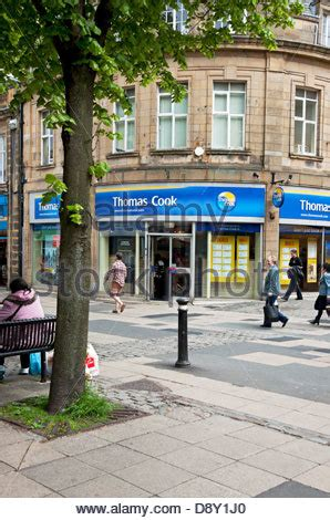 Travel agent Thomas Cook store shop front window Stock ...