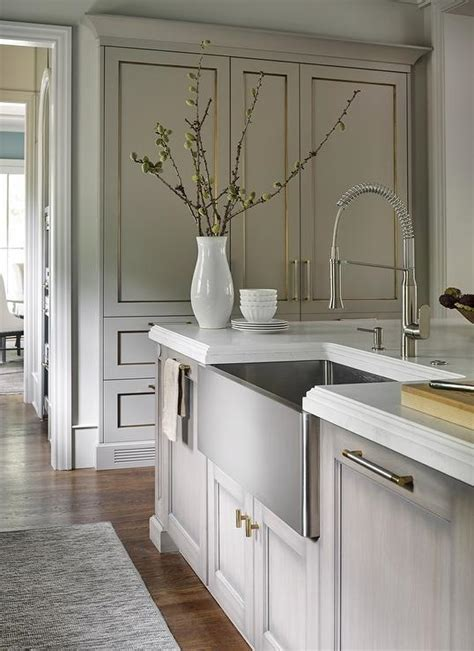 stainless steel apron sink white cabinets gray wash kitchen island with nickel and brass pulls and
