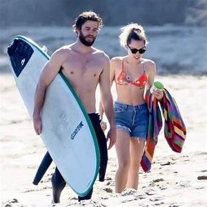 MILEY CYRUS and Liam Hemsworth at a Beach in Malibu 03/01 ...