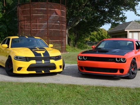 Challenger Hellcat Vs Lamborghini by Dodge Challenger Charger Hellcats Are Faster Than