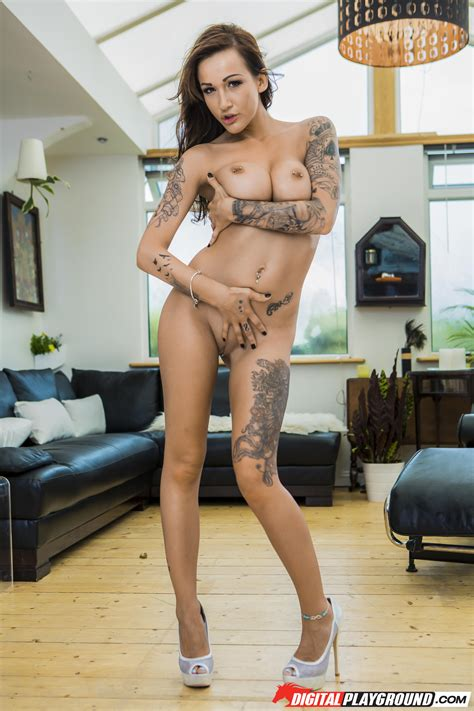 Sexy Tattooed Babe Is Wearing Black Lingerie Photos
