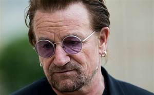 Bono apologises after his charity is hit by bullying ...