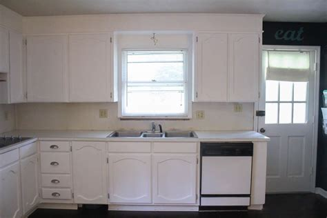 painted kitchen cabinets white painting oak cabinets white an amazing transformation 3990