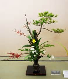 artificial floral arrangements ikebana ikenobo rikka style pine berries white and