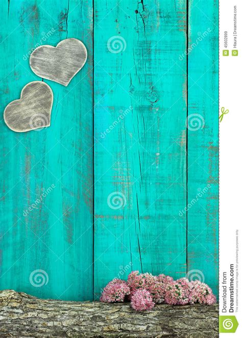 wooden hearts hanging  antique teal blue fence  log