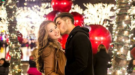 Couple Poses in Christmas Themed NYC Engagement Photos
