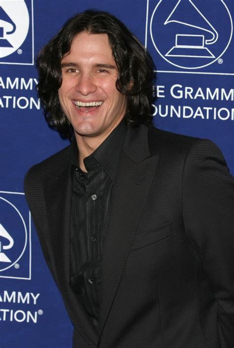 joe nichols sporting  long layered hairstyle  curls