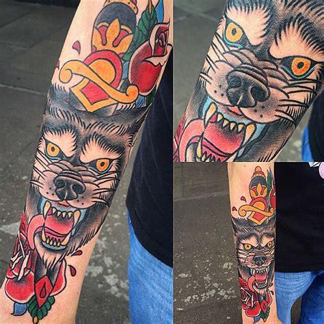 traditional wolf dagger tattoo  sammysurjaytattoo