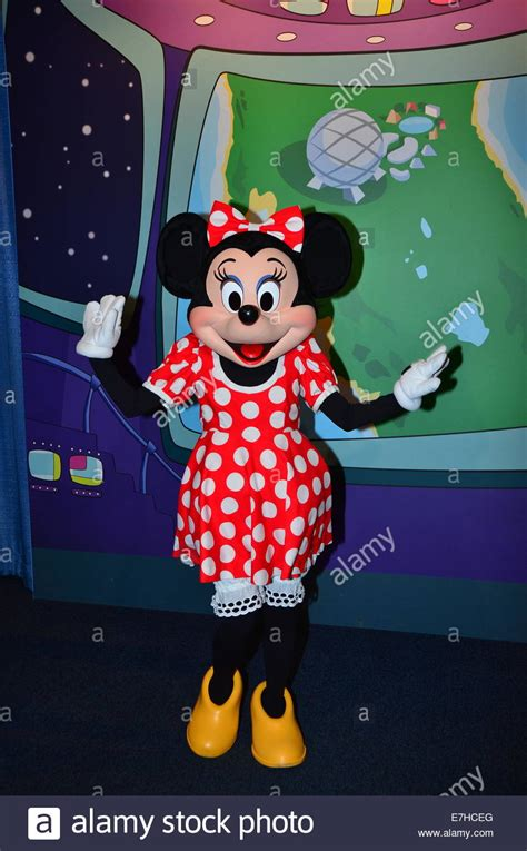 minnie mouse poses for photographs at magic kingdom walt disney stock 73527064 alamy