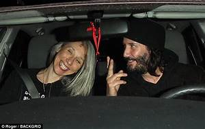 Sad Keanu Reeves smiles again on date with mystery woman ...