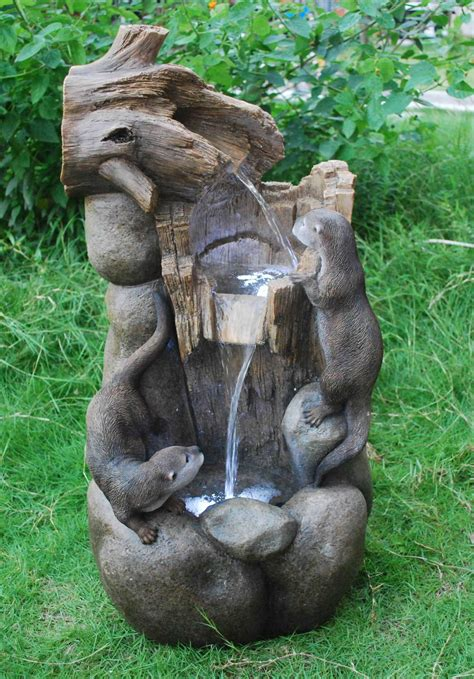 large  otters fall water feature  lights