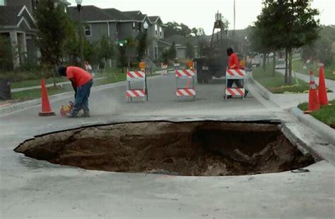 orange county road crews fixing sinkhole  winter garden