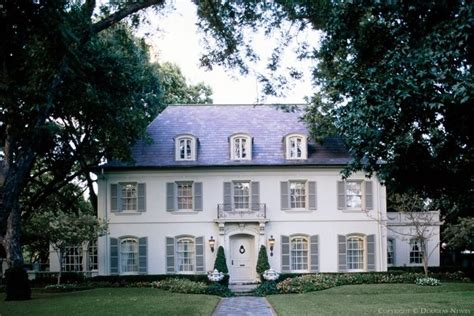 white house with gray shutters from the outside looking in pinter