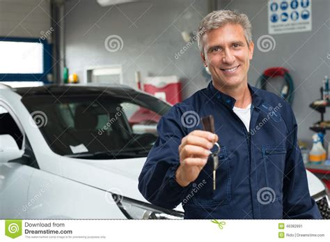 Portrait Of An Auto Mechanic At Work On A Car Editorial