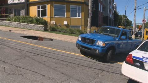 Halloween Candy Tampering News by Driver Unharmed After Car Gets Stuck In Halifax Sinkhole