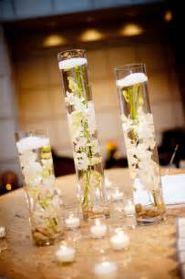 vases for wedding centerpieces real wedding with simple diy details hurricane vases floating white orchids centerpieces