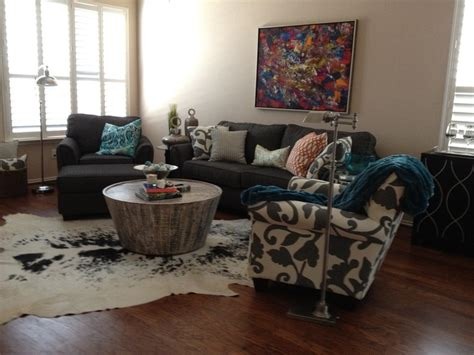 gray turquoise and orange living room with cowhide rug
