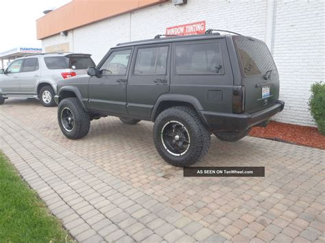 lifted jeep nitro 1997 jeep cheerokee 4 inch lift a c flat black full cage