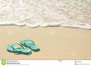 Green Flip Flops on Beach stock image. Image of water ...