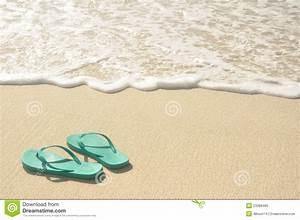 Green Flip Flops on Beach stock image. Image of water ...