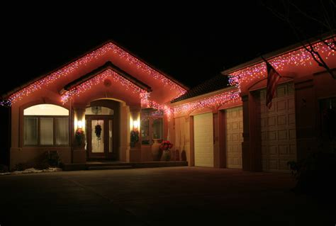 house with red led icicle lights traditional lighting