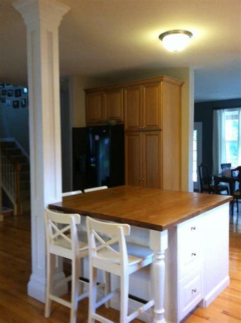 Beautiful White Kitchen Island to Contrast Hardwood Floors