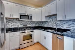 pictures of kitchen backsplashes with white cabinets kitchen backsplash ideas black granite countertops white cabinets white kitchen cabinets black