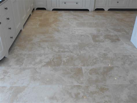 resolving honed travertine tiled floor installation