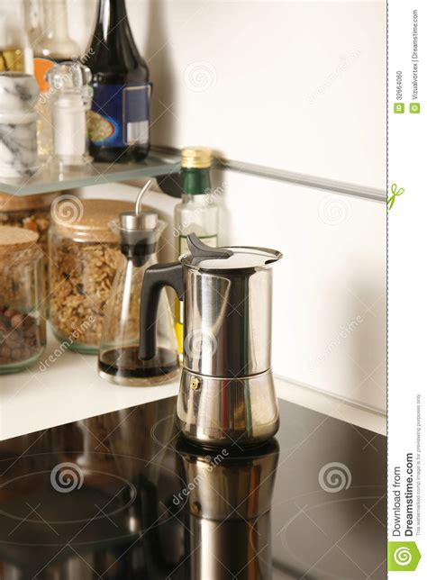 tea and coffee pot on a modern electric stove stock photo image 32664060