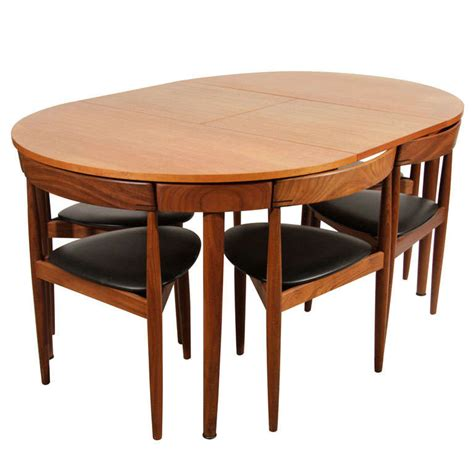 hans teak dining table with extension and six chairs