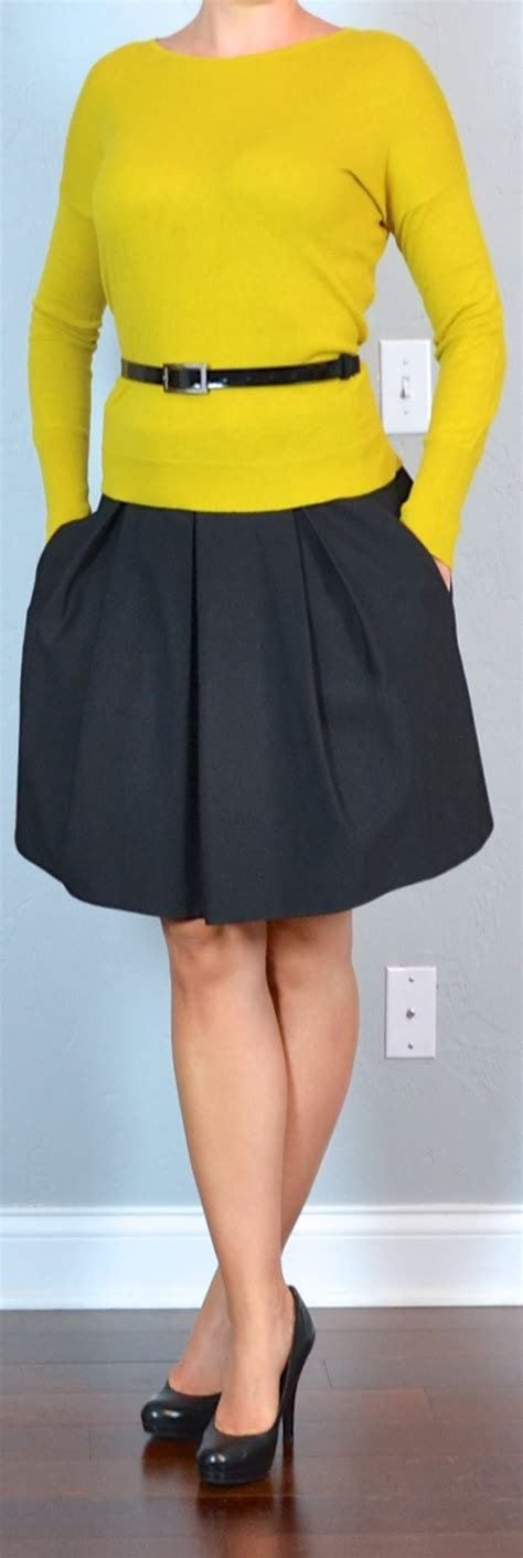 Outfit post mustard sweater black a-line skirt
