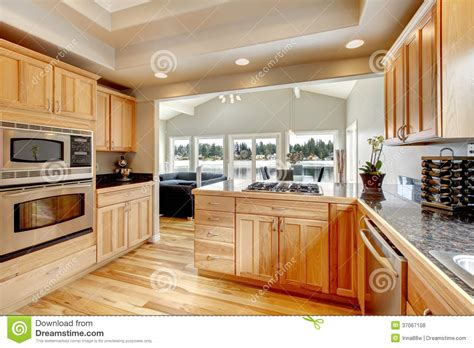 bright wood kitchen  dining area royalty  stock