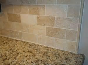 travertine tile kitchen backsplash venetian gold granite with a simple travertine subway tile backsplash with pencil strips accents