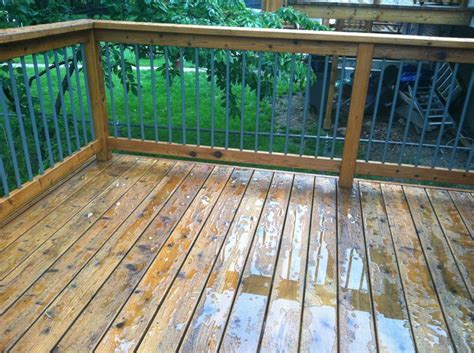 cabot deck stain in wood toned cedar after a rain storm