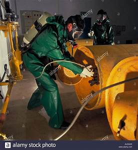 Operators Changing Chlorine Tanks For Use In Water