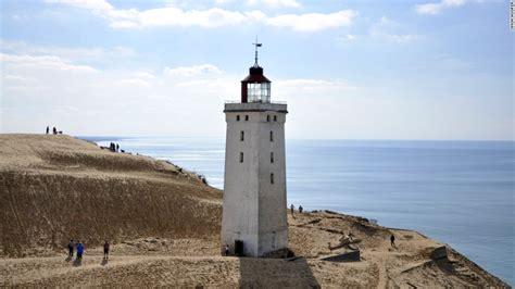 sand dune eats danish lighthouse cnncom