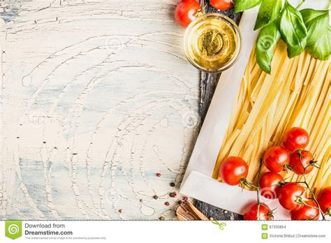 Pasta And Cooking Ingredients: Tomatoes, Basil And Oil On