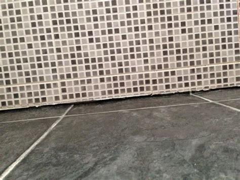Filling gap between vinyl floor and bottom of wall tiles