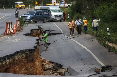 pictured thailand earthquake tears  road  tremors