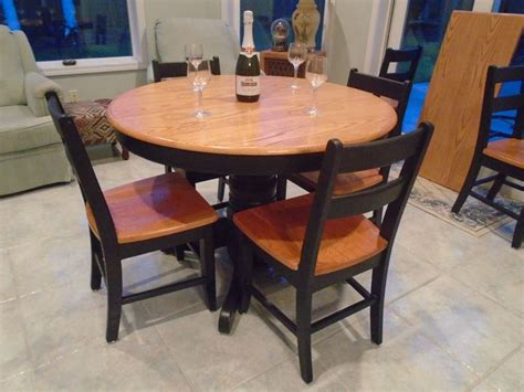 oval pedestal table   leaf brown stained