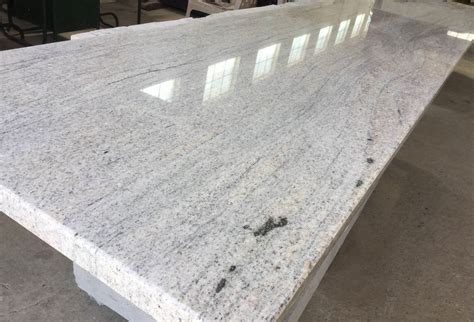 Packing of Imperial White Granite Slabs. The materials