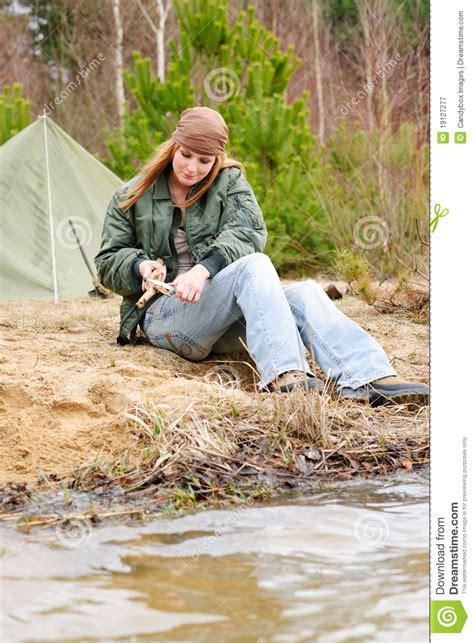 camping woman tent nature cut stick royalty  stock
