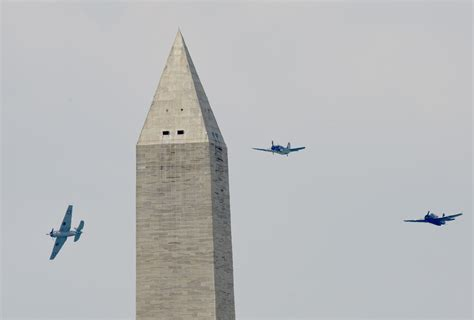 dc planes fly flyover washington wwii aircraft during democracy ww2 arsenal war plane monument era landing unexpected makes ii afp