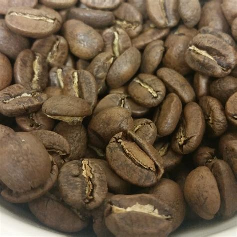 light roast coffee what are these light brown flakes when i grind my coffee
