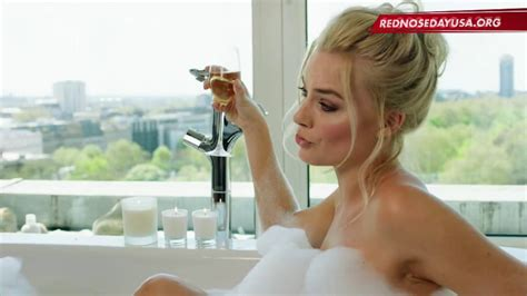 Watch Margot Robbie Take A Bubble Bath For Charity On Red