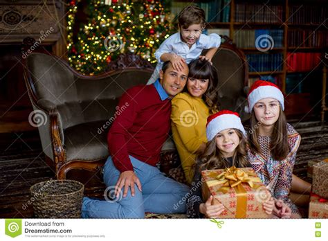 Christmas Family Of Five People, Happy Parents And Their