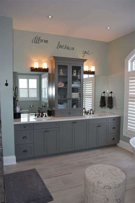 master bathroom with european style linen tower on quartz