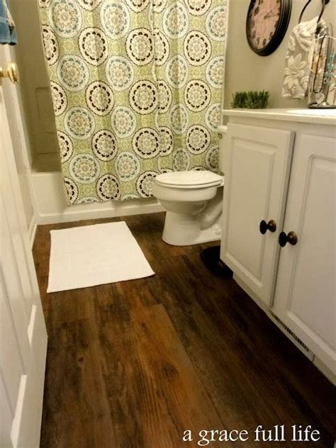 floor and decor woodland lowes antique woodland oak flooring peel and stick vinyl perfect for a bathroom
