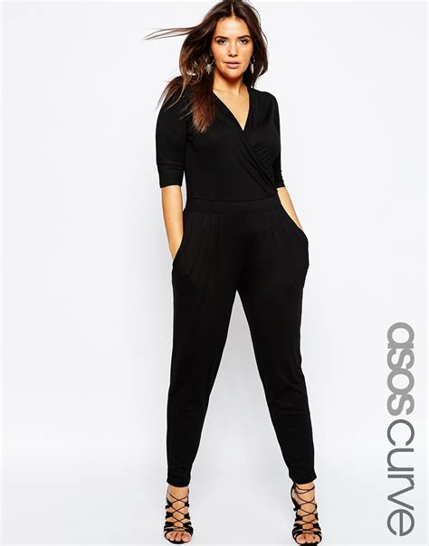 black jumpsuit with sleeves asos wrap jumpsuit with 3 4 sleeve in black lyst